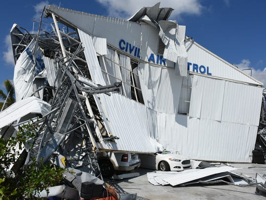 Cars left in the hangar for safety were caught in the