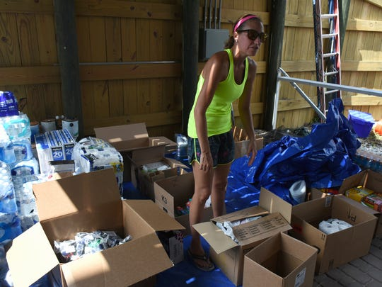 Lori Merenda goes through donations at the group's HQ at 1994 Sheffield Avenue. The Marco Patriots came together as local residents banded together to offer hurricane relief.