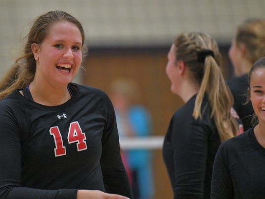 Abi Giese (14) of Lourdes smiles after serving for