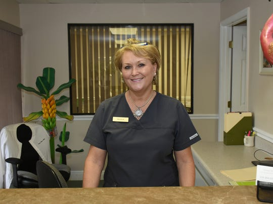 Receptionist Maureen Binkowski is also trained as a dental assistant. Marco Island dentist Robert Branstrator, DDS, offers dental services at reduced rates, targeted to adults who have no dental insurance.