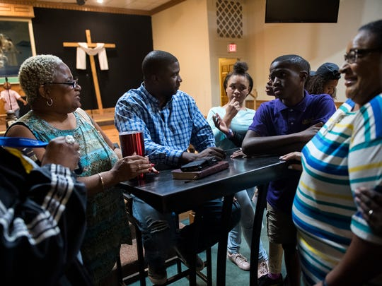 Pastor Darian Blue meets with members of his congregation after bible study at Nicholtown Missionary Baptist Church on Wednesday, Sept. 6, 2017.