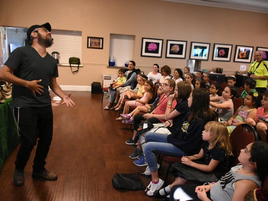 Rabbi Aron Rabin explains the shofar, with a lot of shtick. Chabad of Naples opened a shofar factory at their center on Wednesday evening, giving children the chance to turn animal horns into the shofar, used in Jewish observances.