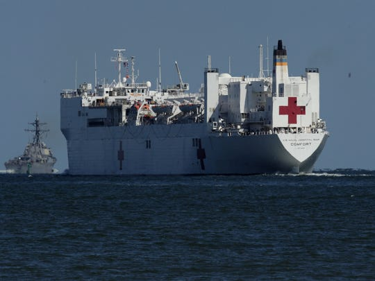 USNS Comfort, the naval hospital ship, leaves the harbor
