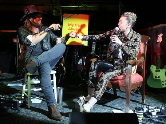 "From left, Billy Ray Cyrus and Miley Cyrus participate in a Q&A at a private concert event at Tootsie's to celebrate the release of Miley Cyrus' album ""Younger Now"" on Friday, Sept. 29, 2017, in Nashville, Tenn. (Photo by Laura Roberts/Invision/AP)"