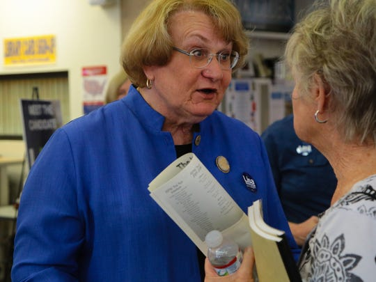 Palm Springs City Council candidate Lisa Middleton speaks with an attendee of a candidates forum held at the Palm Springs Library, Sunday, October 1, 2017.