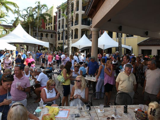 The crowd throngs the courtyard. A concert and fundraiser
