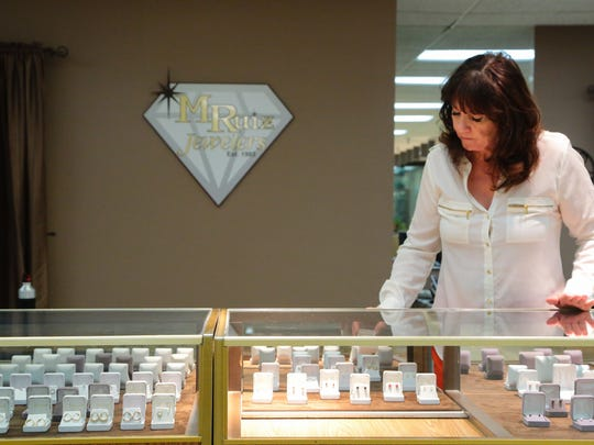 Karen Ruiz works in her jewlery store at the Indio Mall, September 14, 2017.