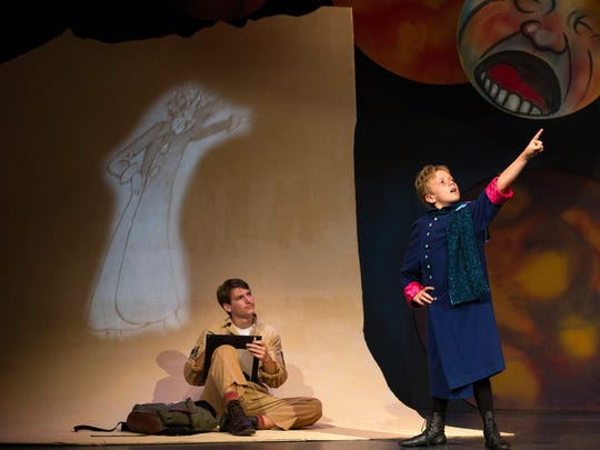"""The Little Prince (Luke Dahl) tells the Aviator (Trevor Sexton) of his travels through space in the Oak Ridge Junior Playhouse production of """"The Little Prince."""""""