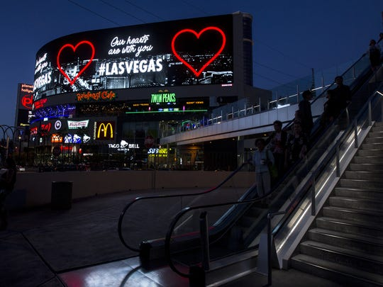 "A message stating ""Our hearts are with you"" is displayed along Las Vegas Boulevard on Tuesday, Oct. 3, 2017 in Las Vegas, Nev. Stephen Paddock was accused of shooting into a crowd of people at a concert from his hotel room at Mandalay Bay in Las Vegas on Sunday night, resulting in the deadliest mass shooting in U.S. history."
