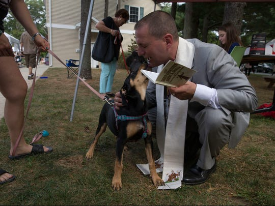 Chaplain Matty Giuliano blesses Roxy. The Monmouth