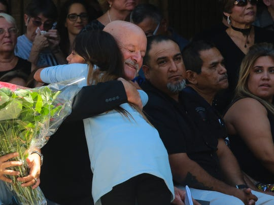 Vanessa Vega, daughter of Officer 'Gil' Vega, embraces