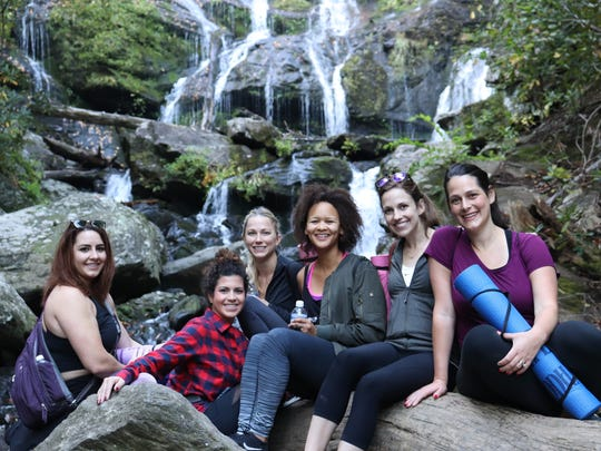 A group of women recently took a Namaste in Nature class at Catawba Falls.