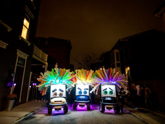Blink Cincinnati transforms Pleasant Street with light installations, murals and more. These whimsical carts also appeared in Thursday's Blink Cincinnati kick-off parade.