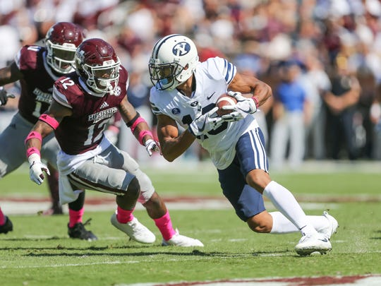 Mississippi State's J.T. Gray (12) zeroes in om BYU's