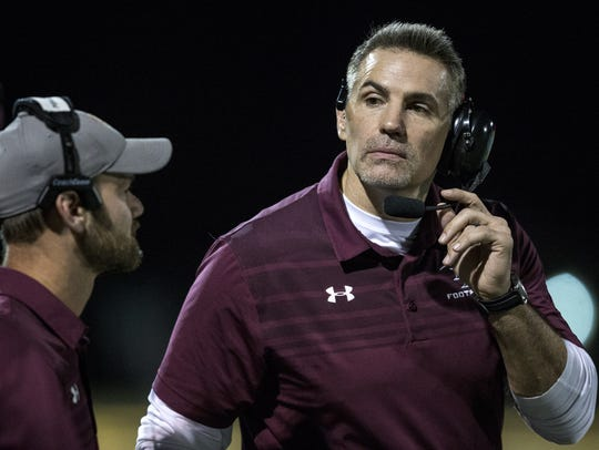 Desert Mountain coach Kurt Warner talks to players