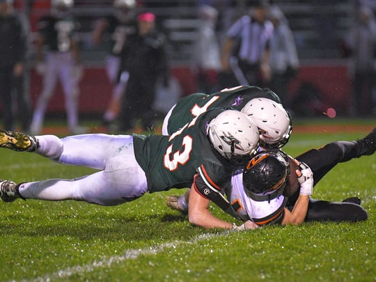 Richard McMartin (53) of Berlin brings down Cade Jahns (44) of Berlin. The Berlin Indians hosted the Ripon Tigers Friday evening, October 13, 2017 in an East Central Conference football matchup.