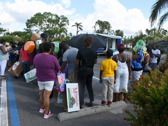 Recipients line up to fill their containers at Lely Presbyterian Church Monday afternoon. Meals of Hope operates a mobile food pantry that distributes groceries and essentials at four locations in Southwest Florida Monday through Thursday.
