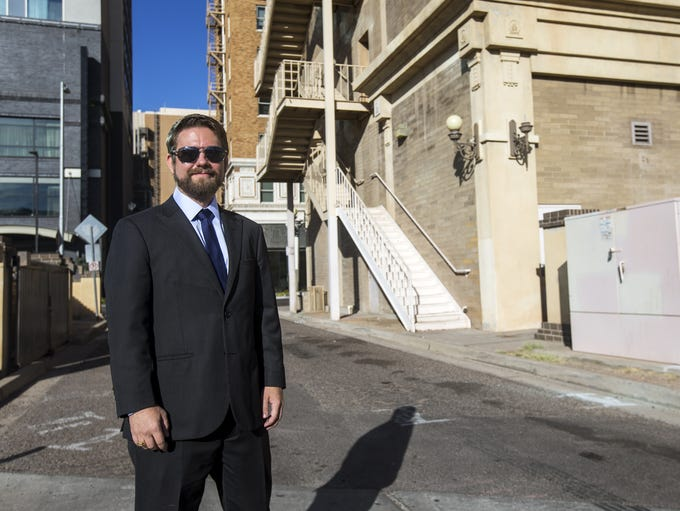Sean Sweat is pictured in the alley behind the historic