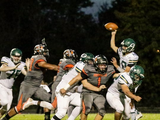 Greenwood QB Seth Gallman looks for an open receiver against Beech Grove in sectional action Friday.