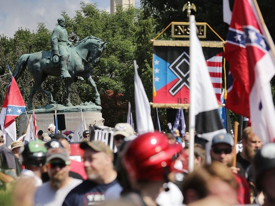 Hundreds of white nationalists gather at a statue of