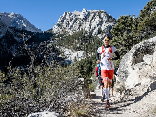 This Oct. 15 photo provided by Salomon shows professional trail runner Francois D'haene running on the John Muir Trail in the California Sierra Nevada mountain range. D'haene, a French winemaker took fewer than three days to cover 221 miles up Mount Whitney and across the John Muir Trail through Sequoia, Kings Canyon and Yosemite National Parks.