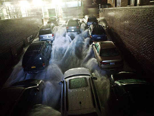 Rising water, caused by Hurricane Sandy, rushes into