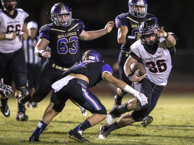 Williams Field's Jaden Carroll rushes against Queen