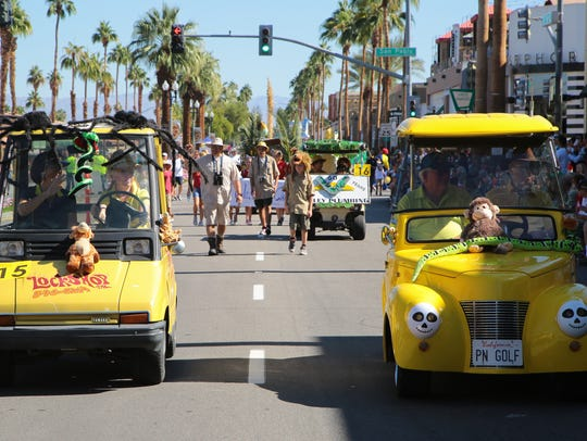 Carts from local businesses are shown riding in the Palm Desert 2017 Golf Cart Parade.