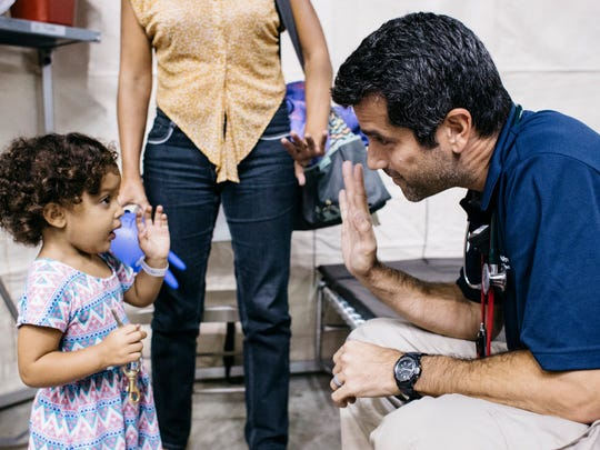 Dr. Christopher Tedeschi from New York-Presbyterian/Columbia University Medical Center, says goodbye to a patient, Janeiviz Rosario, at a federal shelter in Manati, Puerto Rico, on Oct. 22, 2017,