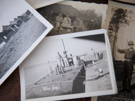 """Old photographs of Herbert """"Mac"""" MacMillan's time in WWII sit on a desk in his room on Wednesday, Oct. 25, 2017."""