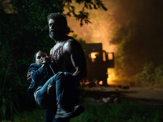 "This image released by Twentieth Century Fox shows Dafne Keen, left, and Hugh Jackman in a scene from ""Logan."" (Ben Rothstein/Twentieth Century Fox via AP)"