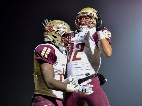 Riverdale's Savion Davis (11) celebrates scoring a touchdown against Mt. Juliet with Shaun Morrow (82) during the second half at Mt. Juliet High School in Mt. Juliet, Tenn., Friday, Nov. 3, 2017.