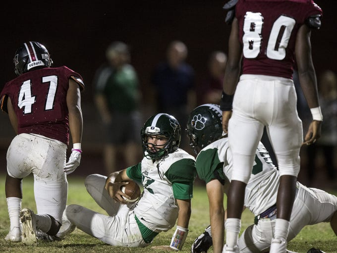 Horizon's Jake Martinelli lies on the ground after