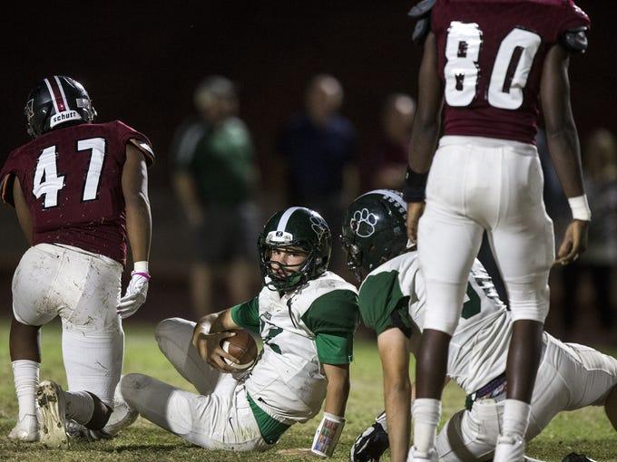 Horizon's Jake Martinelli lies on the ground after