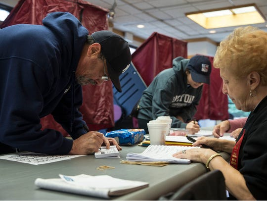 Voters come out to cast their votes at Toms River Town