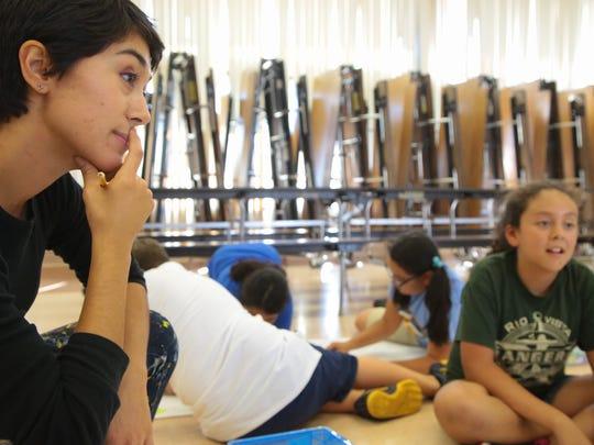 Artist Sofia Enriquez teaches students in an afterschool