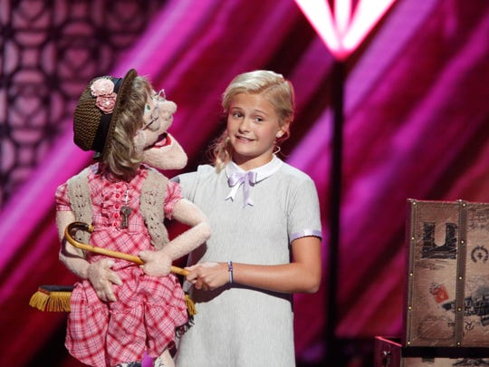 America's Got Talent Season 12 winner Darci Lynne Farmer with one of her puppets.