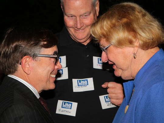 Lisa Middleton speaks to Mayor Robert Moon at her election night party in Palm Springs, November 7, 2017.