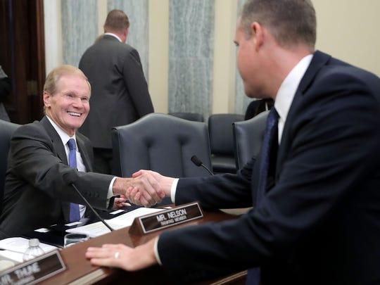 Sen. Bill Nelson, D-Fl., (L) greets Rep. Jim Bridenstine