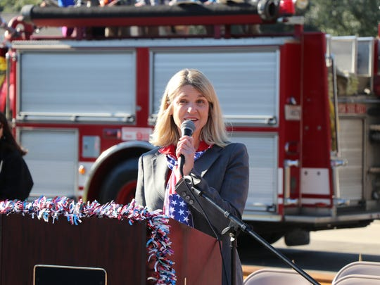 Woodvale Elementary Principal Monique Vidos speaks to the audience at a school event honoring veterans and first responders.