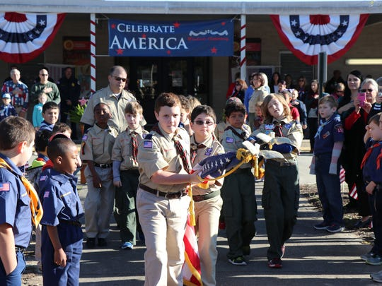 Scouts present the colors at the Woodvaie Elementary's