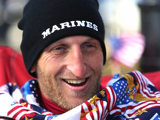 Veteran Rob Jones takes a break before starting the final segment of his marathon month. He ran along the National Mall on Nov. 11. It was his 31st marathon in as many days.