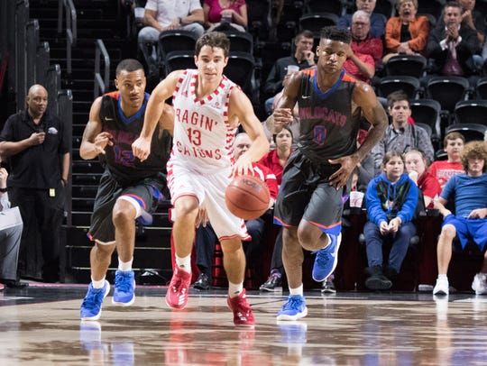 Jacob Broussard, awarded a scholarship last week, dribbles on the break for UL against Louisiana College earlier this season.
