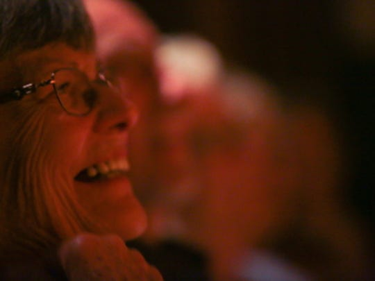Audience members laugh as they listen to Andrew John's story at the Coachella Valley Storytellers Project at Camelot Theaters, November 13, 2017.