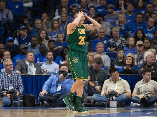 Vermont's Ernie Duncan reacts after a missed shot late in Vermont's 73-69 loss at Kentucky on Sunday.