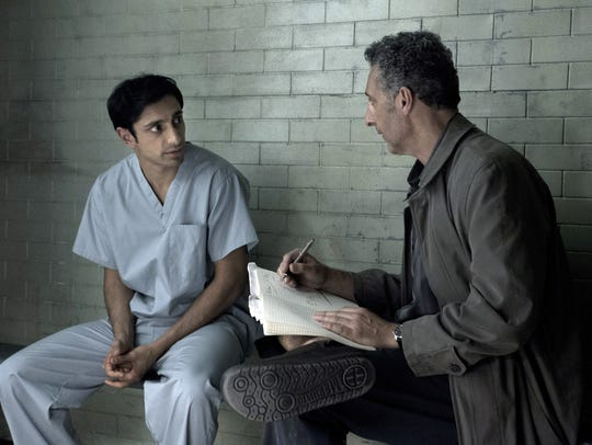 "In this image released by HBO, Riz Ahmed, left, and John Turturro appear in a scene from ""The Night Of."""