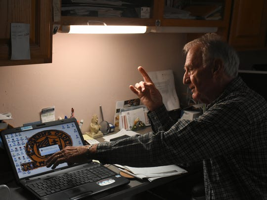 Former FBI special agent Tom MacGeorge in his study.