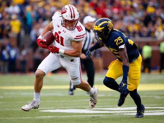 Wisconsin tight end Troy Fumagalli runs after a catch against Michigan during their game in 2016.