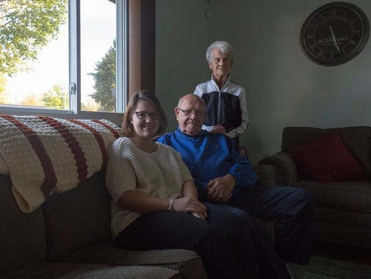 Amber Hauer, left, sits with her grandparents, Don