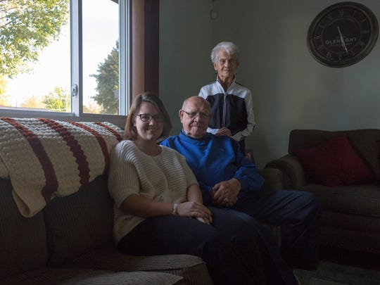 Amber Hauer, left, sits with her grandparents, Don and Barbara Plotzka, who helped her with a loan to buy her Sterling Heights house, on Nov. 3, 2017.